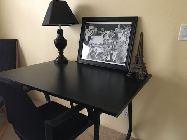 A drafting table provides a desk top area for working guests.
