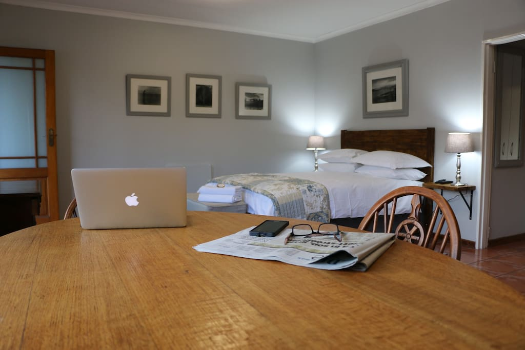 Interior of flat, ample space to work or eat at 4 seater oak dining room table.