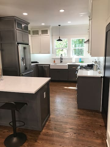 Kitchen with quartz, new top of the line appliances, and farmhouse sink.