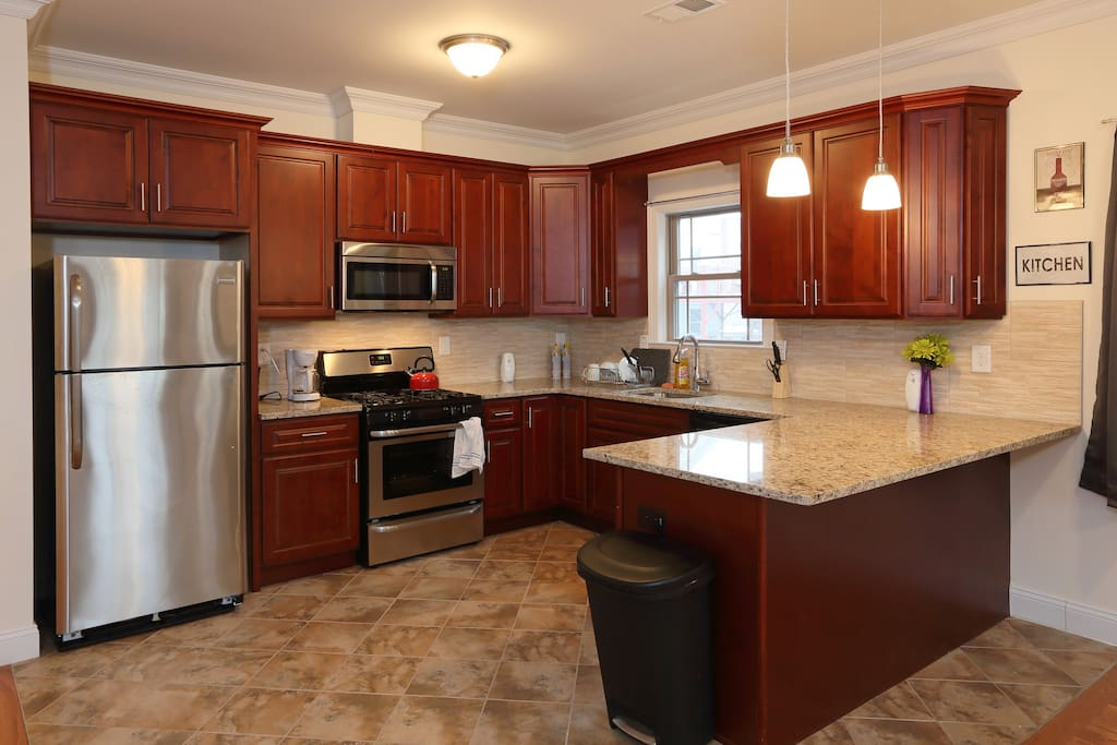 The kitchen contains a microwave, coffeemaker, dishwasher, plates, pots and pans -- everything you might need.