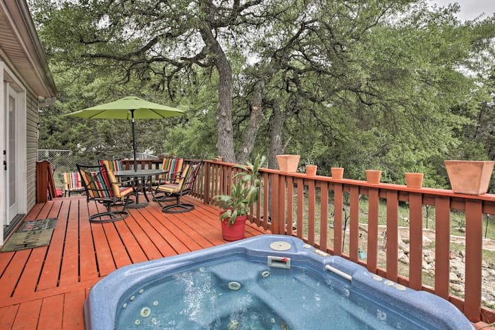 Sink into the hot tub and enjoy the lush Texas Hill Country scenery.