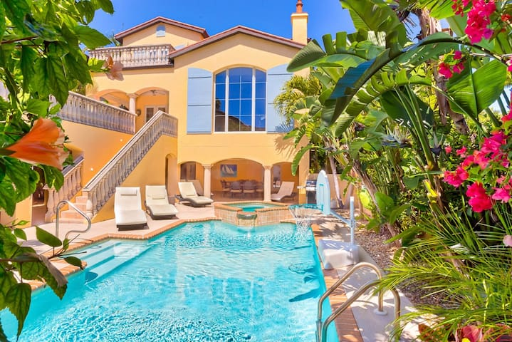 Spectacular pool with spa, bball goal, sun ALL day, massive covered patio, ping pong table, ring game, huge dining table, entrance to 1st floor rooms, bath & elevator.