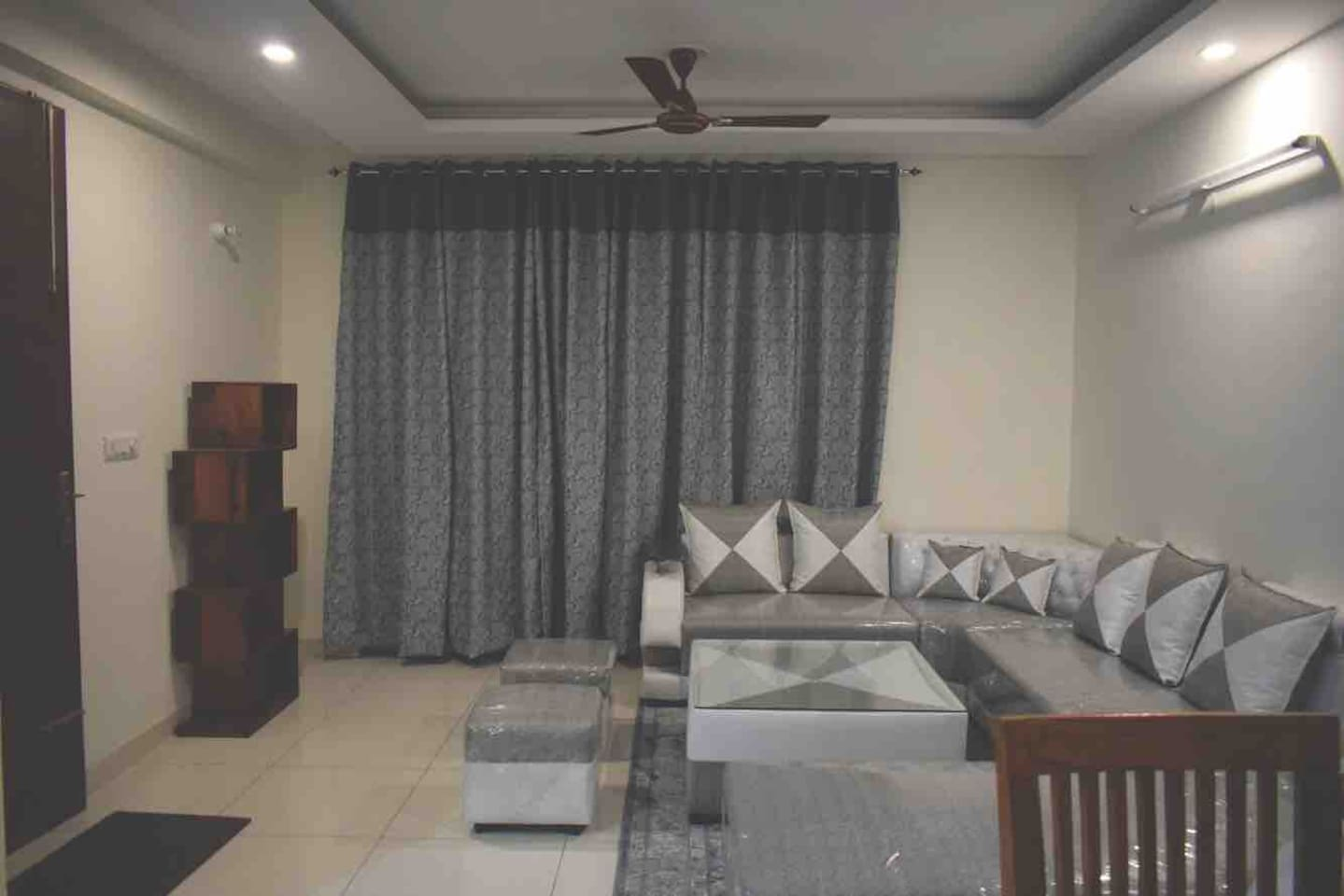 Living room with seven seater sofa set and one couch for exclusive use by guests