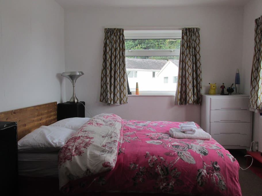 the double bedroom. fantastic views across to the mountains.
