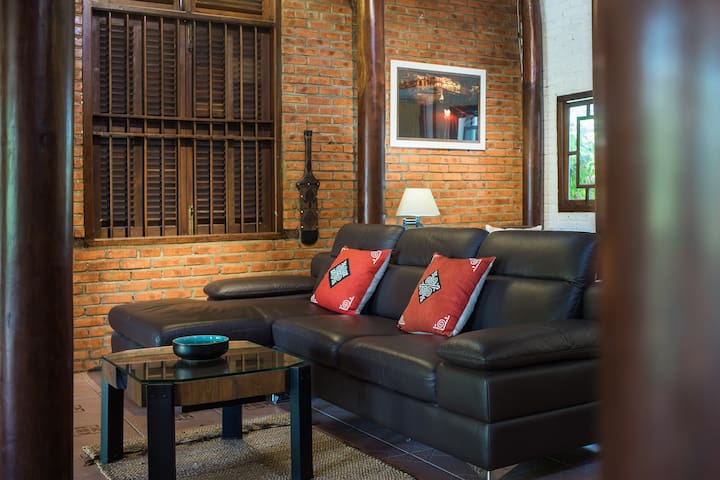 Modern L-shaped sofa with retractable headrests  - perfect for relaxing with drinks or playing one of the many popular board games available.