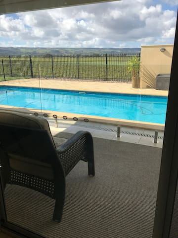 Relax by the pool, and soak up the views of McLaren Vale