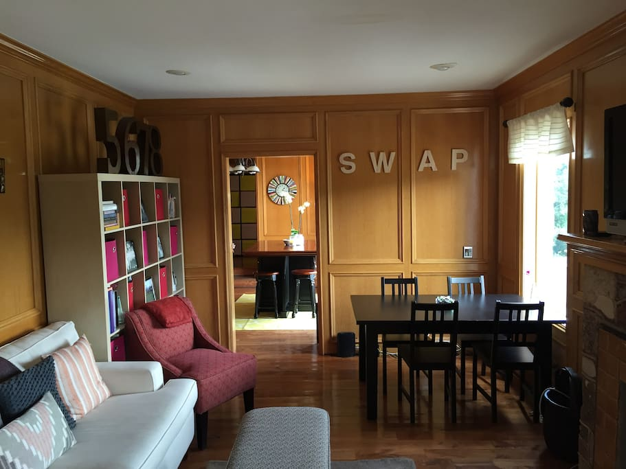 Our living room that has Apple TV, a ton of great books, and blazing fast internet!