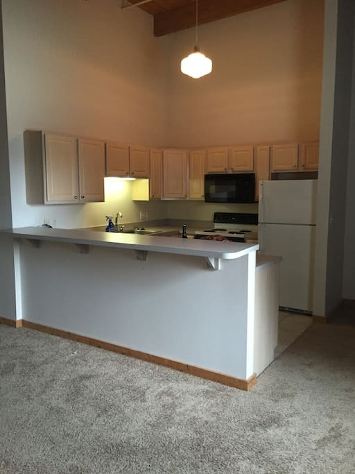 Kitchen: Refrigerator. Dish Washer. 4 top stove. Oven