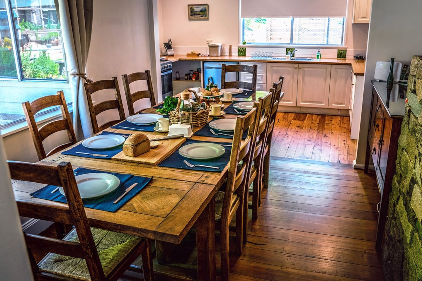 Spacious farmhouse table comfortably seating 8 people