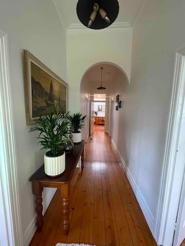 The magnificent colonial hallway which connected all bedrooms and the living will welcome you as you enter the THE COOPERAGE. Decorated with black hanging rustic hanging lights to match the Victorian age.