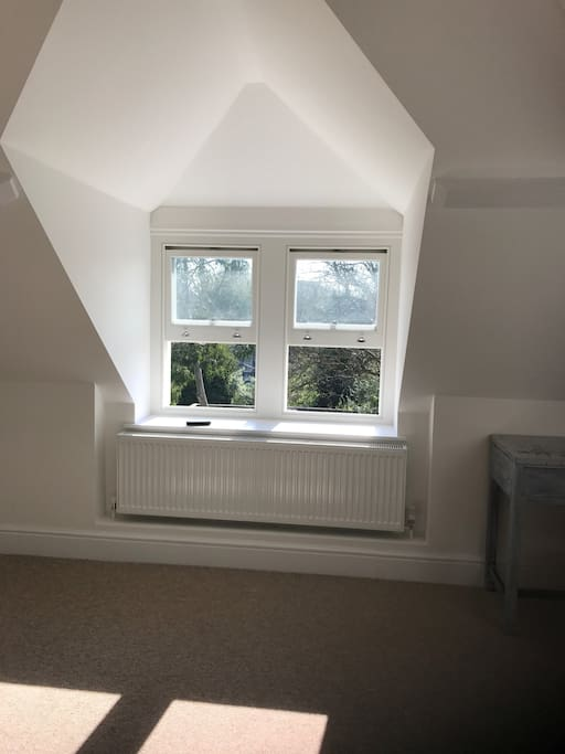 It is a very bright room with both dormer windows and a skylight