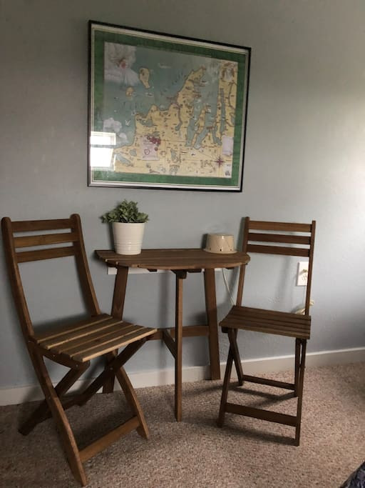 A small table and chairs is a perfect spot to enjoy your morning coffee or a glass of wine and a snack.