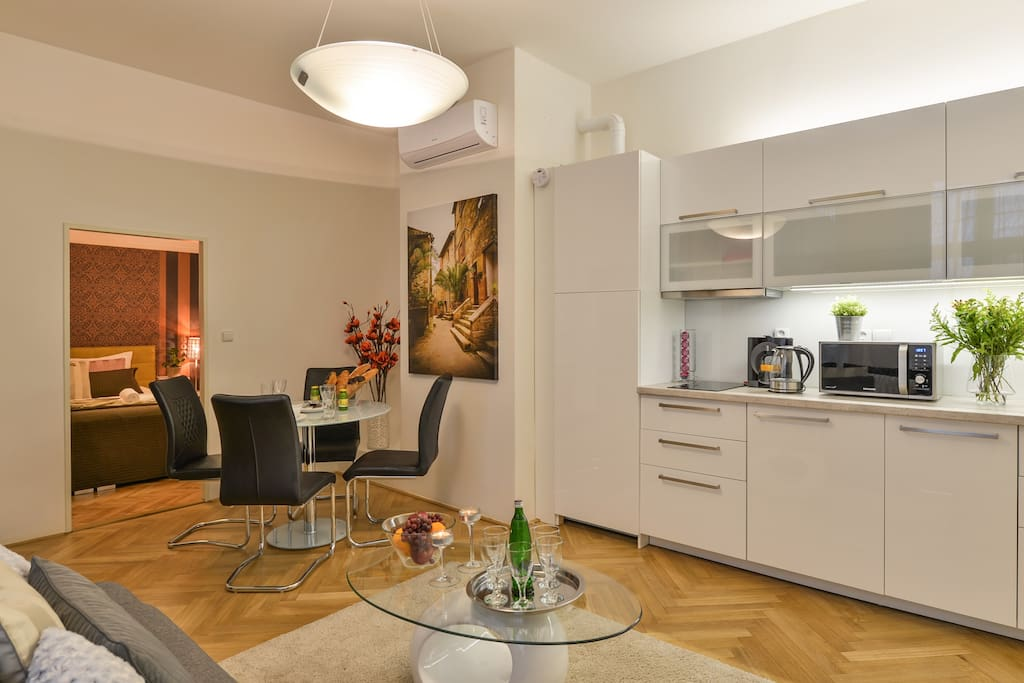 spacious living room with fully equipped kitchen and TV with international programmes
