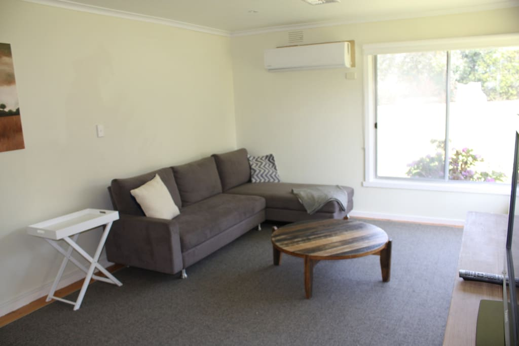 Large living room with westerly rural views.