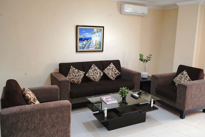 1 master king-sized bedroom with an attached bathroom, 2 single bedrooms, second bathroom at living room area, living room, dining area and kithenette