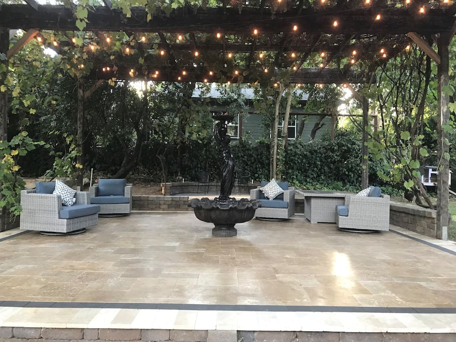 Relax, have a cup of coffee and enjoy a conversation under our grape arbor over our new travertine patio located steps away from your door.
