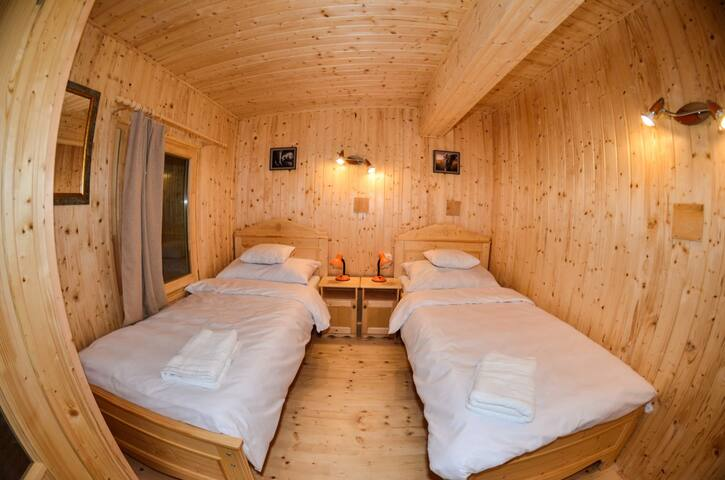 Upstairs room with two simple beds.