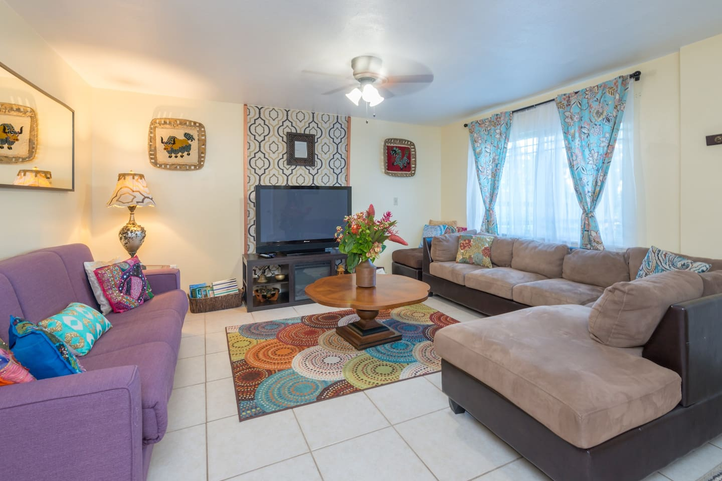 The cozy living room welcomes you in.  This is a great place to unwind after a day at Orlando's theme parks.    There is an electric fireplace under the television to warm you up on those few days a year that Florida gets chilly.