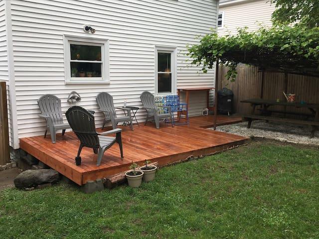 Backyard deck, grape trellis, and picnic table