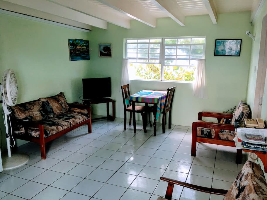 Bright and breezy living and dining area with TV and telephone