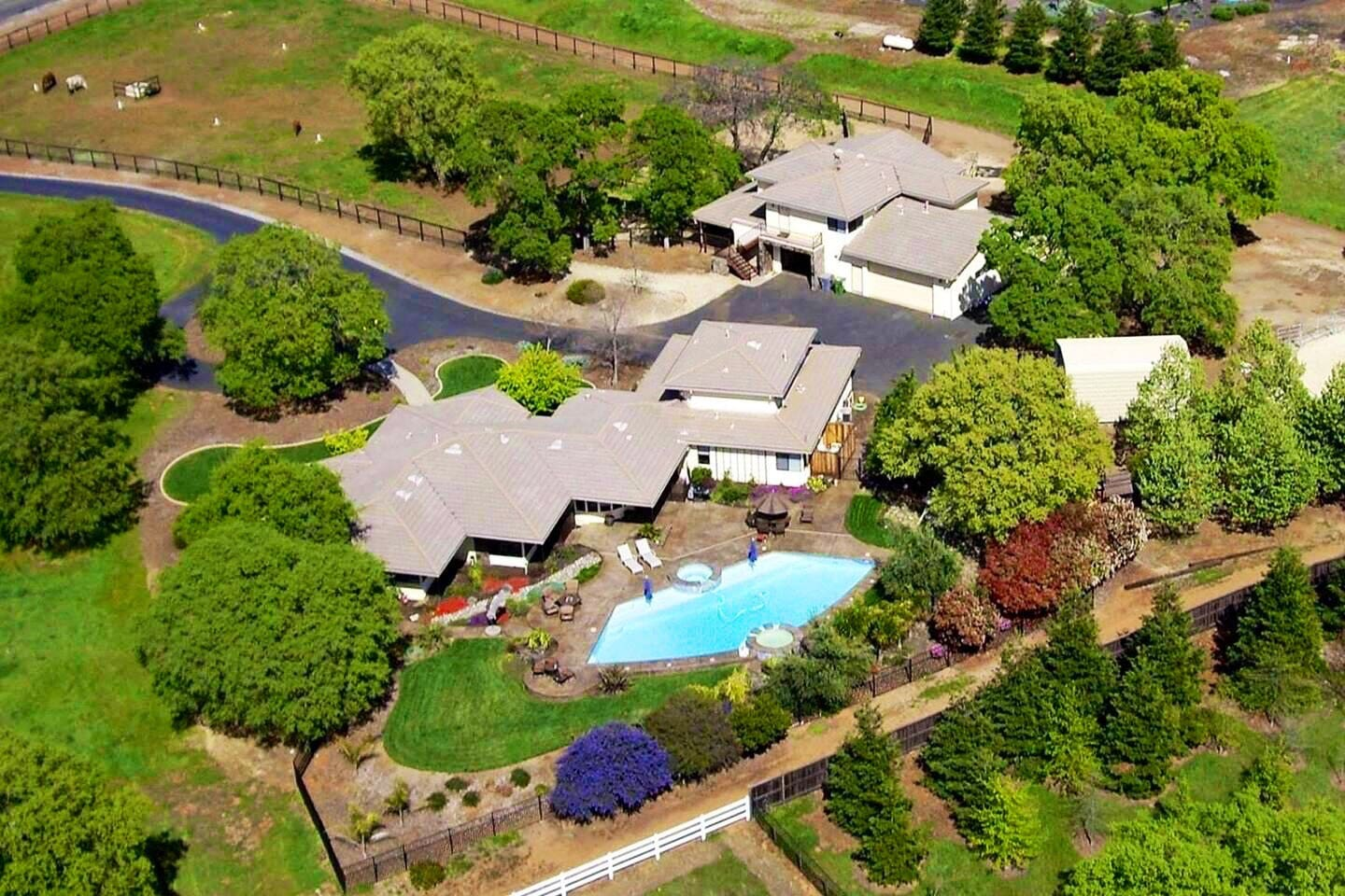 Aerial view of main house, guest house and swimming pool