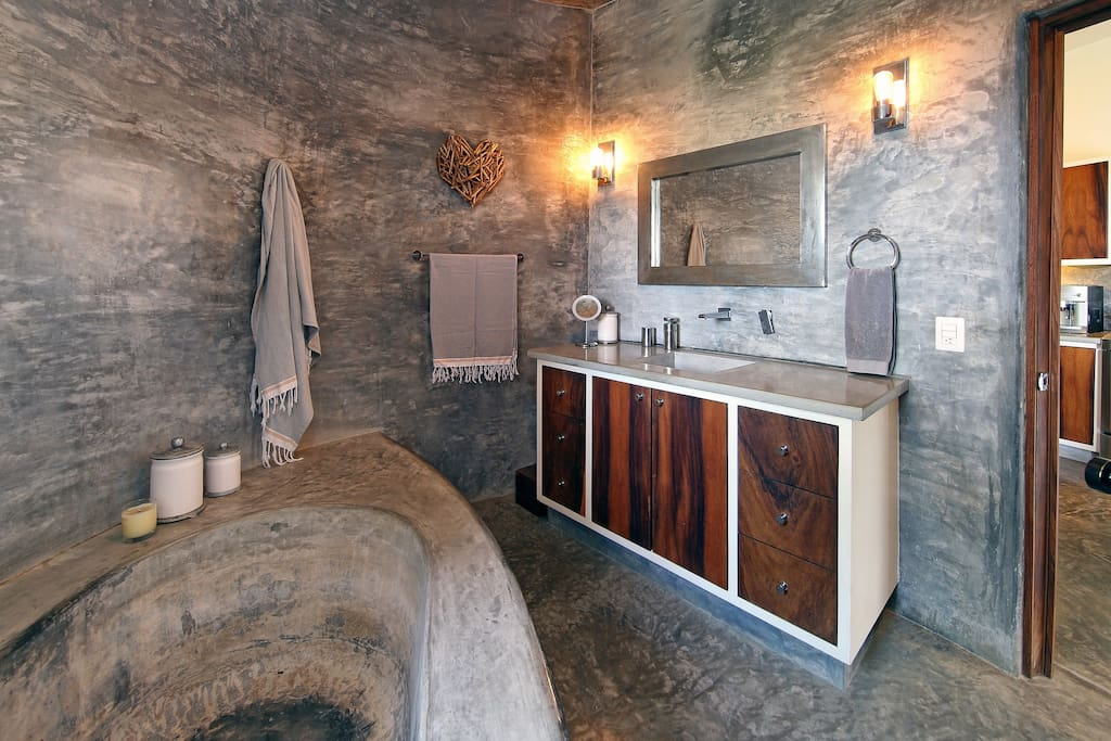 Main level bathroom with large tub and rain shower