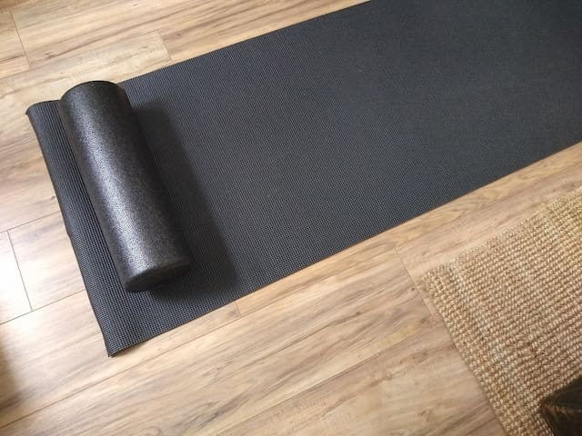 Yoga mat and foam roller are located in the bottom of the downstairs closet.