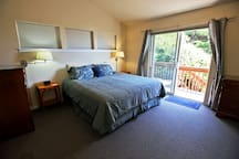Master bedroom with a King bed, private bathroom, cable TV/DVD and a slider leading to the back deck.