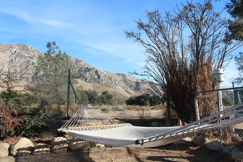 View of the mountains from the front yard with hammock for ultimate relaxation.