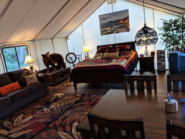 Canvas cabin is spacious, with all the comforts of home.  Glamping...glamorous camping...at it's finest. Memory foam beds, comfy couch, table with 4 chairs, games, coffee cart, and yes, old-school TV/VCR with 40 movie selections!