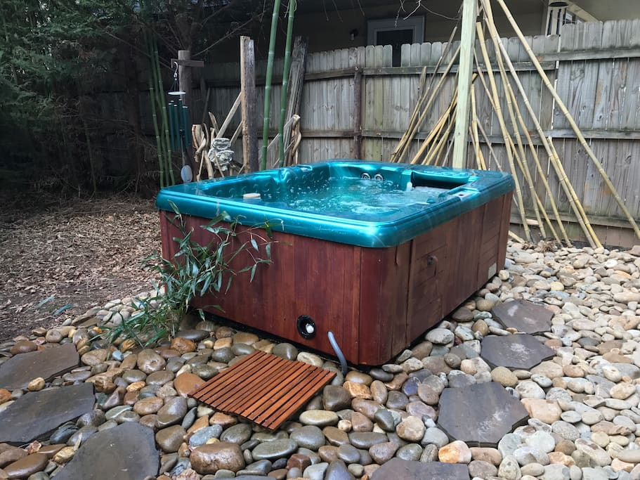 Massaging hot tub in our little urban oasis awaits.