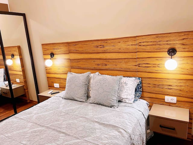 The second bedroom has sea view, Mountain View and pool view. It has a Queen sized bed, Samsung smart TV, LG A C, iron, iron board, extra towels/ bedding sheets, comforters and blanket.
