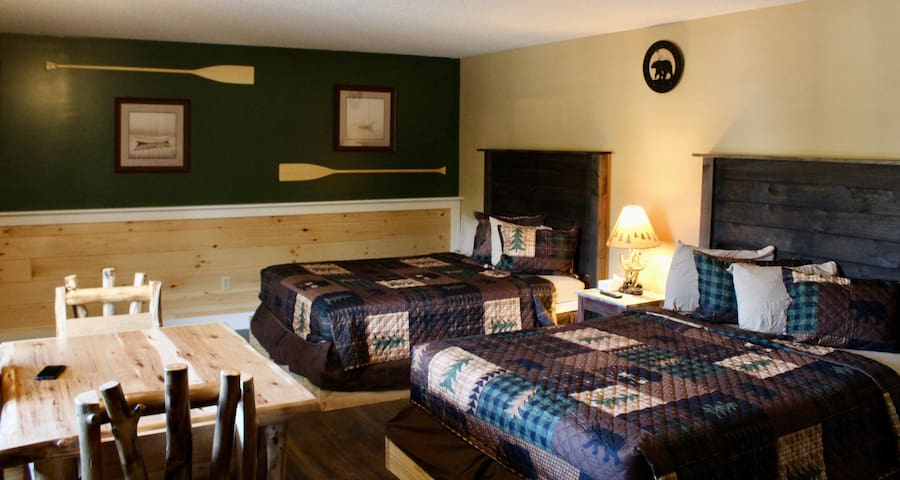 Newly renovated lakefront room with kitchenette overlooking pool, hot tub and Lake George