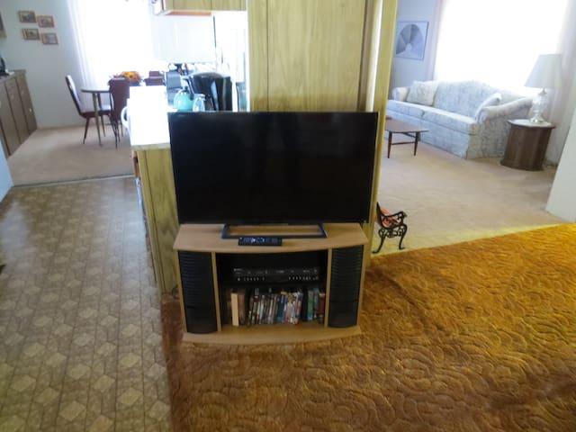 Flat screen TV, Netflix, DVD and VHS player.