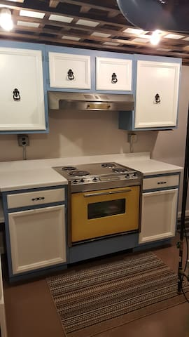Kitchen Range w/ Hood and Cabinets