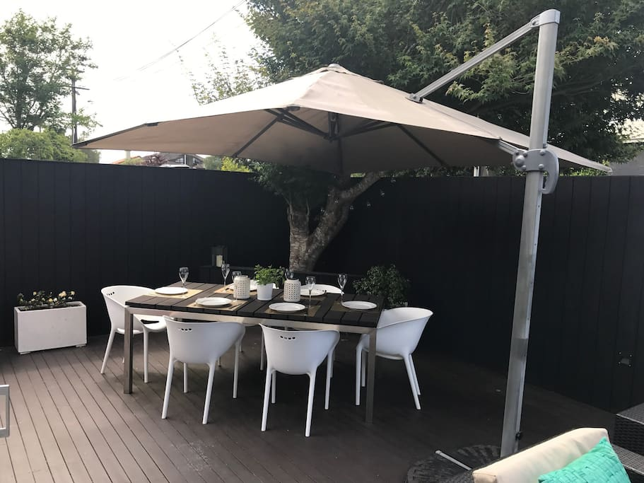 Outdoor dining and BBQ with deck around to pool