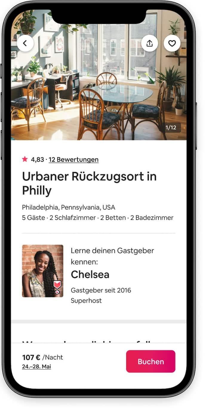 """Ein Bildschirm der Airbnb-App mit dem Bezahlvorgang für Gäste, mit dem Foto einer Küche, Gastgeber-Details und einem """"Buchen""""-Button"""