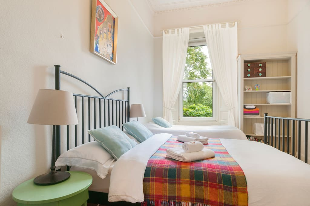 Main bedroom, sleeps up to 3 on a very comfortable double and single bed. Open views over greenery, very quiet and peaceful.