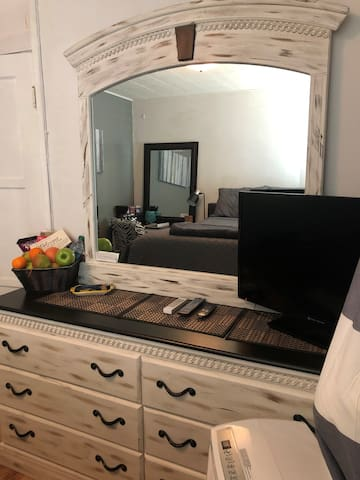 Dresser and TV.  TV has a Roku Stick with Netflix.  A different type of welcome is always available for guests enjoyment.