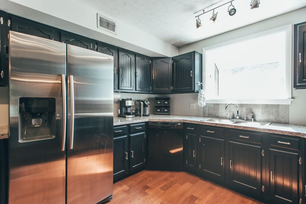 Kitchen with large stainless steel refrigerator