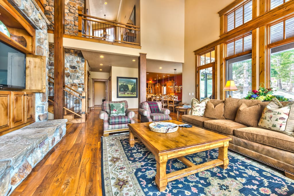 Main living room with large HD TV/DVD, private deck with an 8-seat table, BBQ Grill, and amazing views
