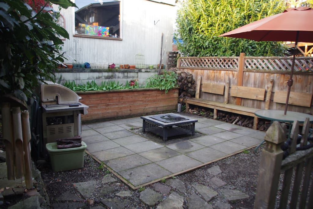 Back patio with fire pit and and BBQ