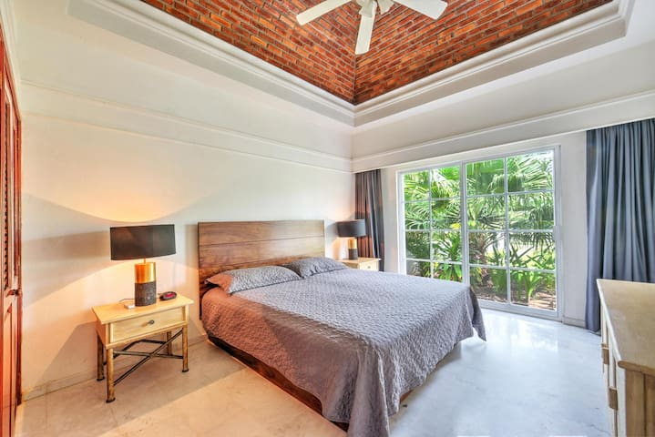Bedroom 2 - king bed. Overlooks private complex park.
