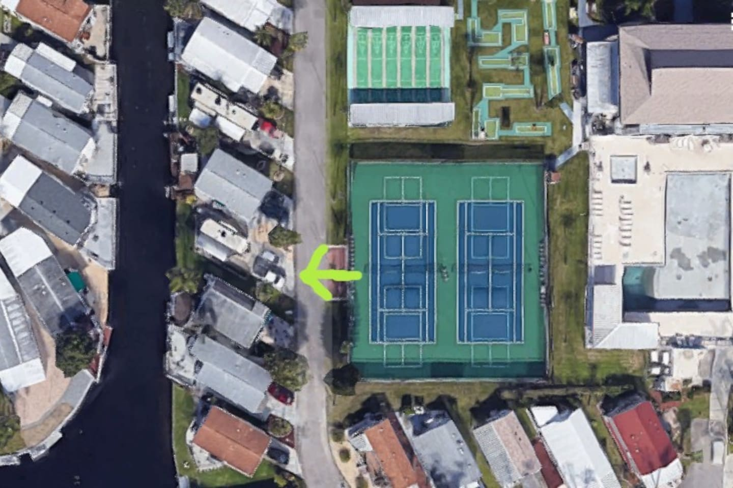 This is a satellite image of the RV pad note the proximity to the tennis court and a large swimming pool and clubhouse.
