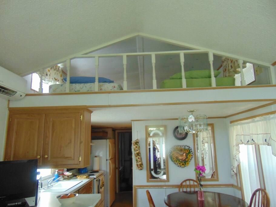 View of overhead sleeping loft/slumber-party room.