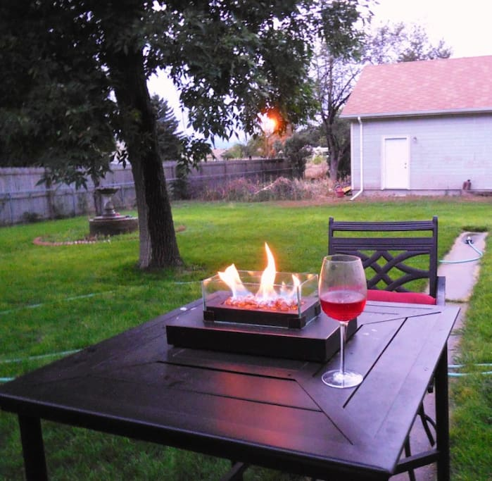 Enjoy a romantic dinner with a table top fire pit in our back yard