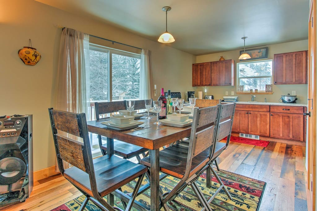 The interior features reclaimed barn wood floors for a cozy, cabin-like atmosphere.