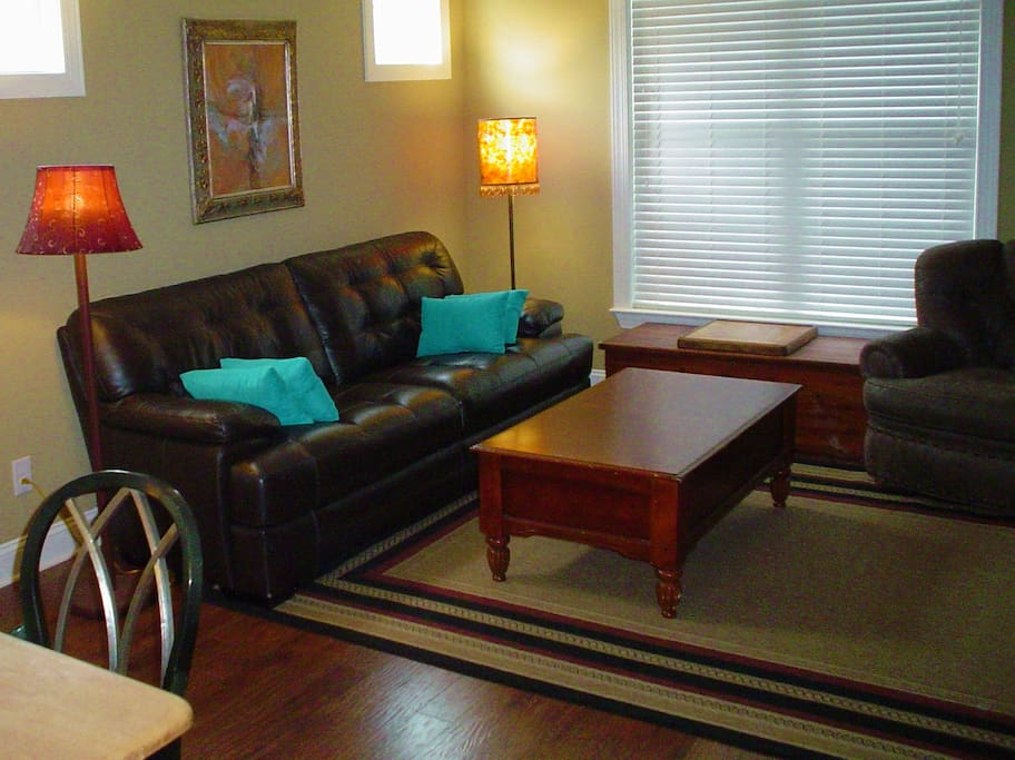 Living room features large leather sofa and easy chair
