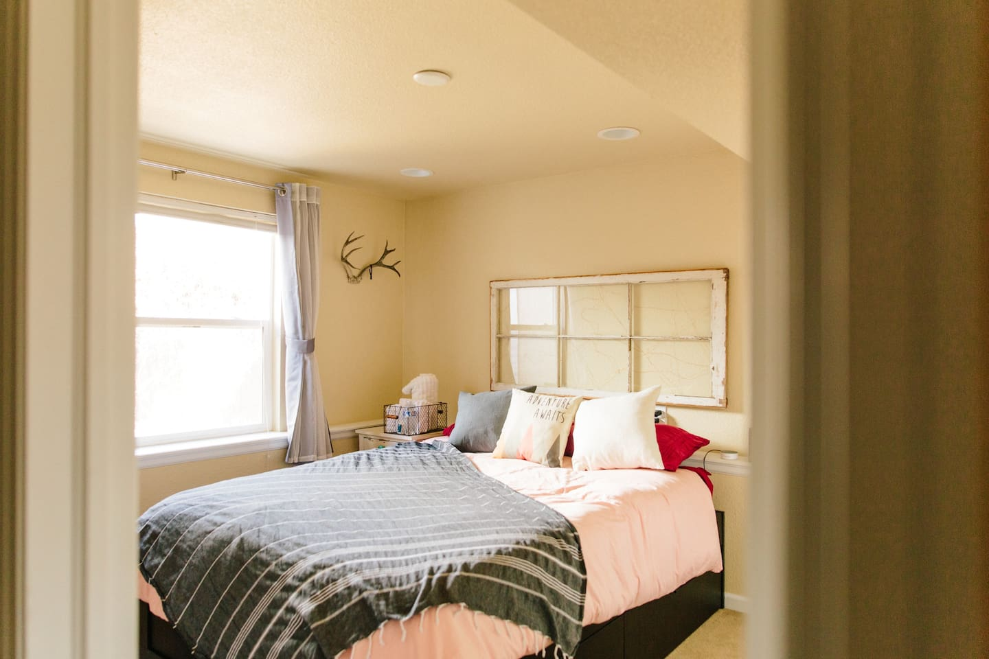 The Colorado Room, queen bed with storage space underneath. This is one of two separate private rooms we offer in our home.