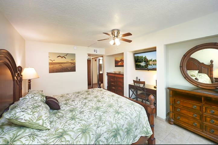 Large King Master Suite with a desk work space and 2 large dressers.